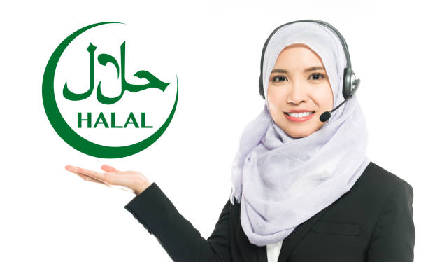 A lady showing the Halal sign