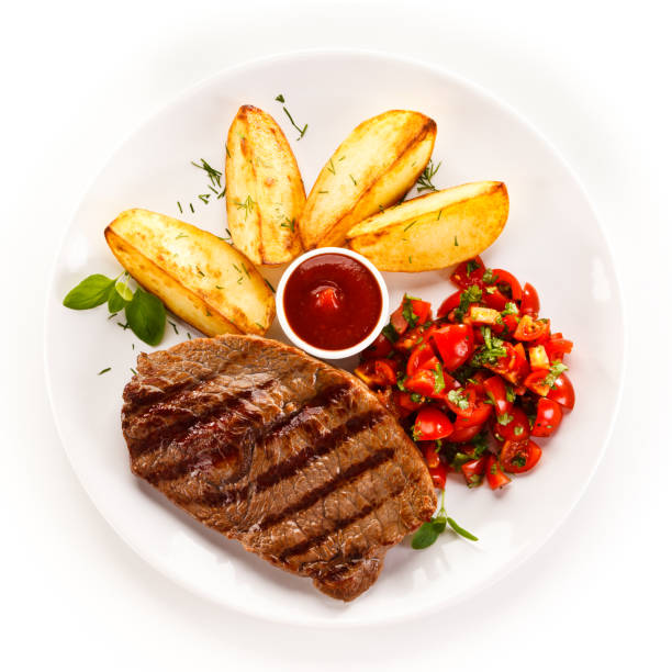 Halal beef and french fries served with tomatoes