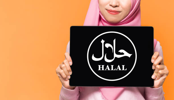 Lady holding Halal sign